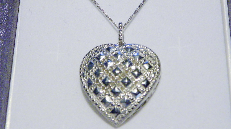 Diamond heart pendant in Platinum over Sterling (.25 carats) w/chain