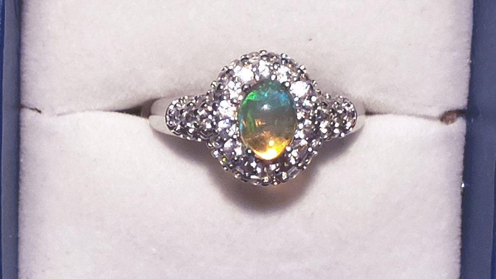 Ethiopian Welo Opal and white zircon halo ring in platinum/925 sterling size 7