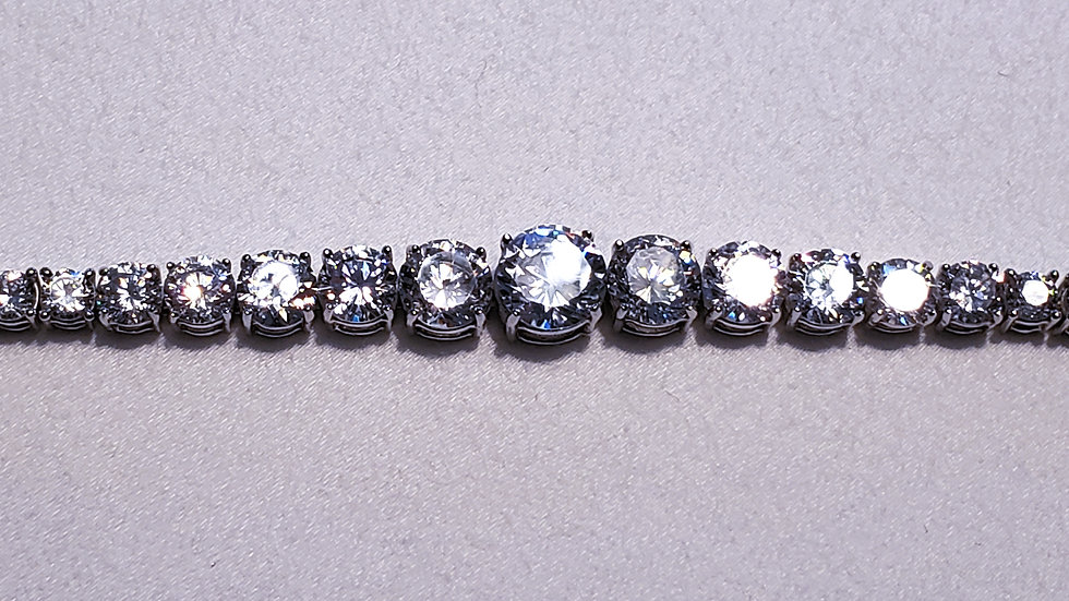 Graduated Cubic Zirconia tennis bracelet in Rhodium over 925 Sterling 22.22 cts