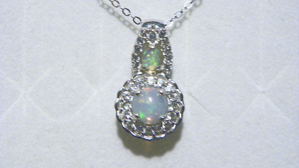 Ethiopian Welo Opal and white zircon halo pendant with chain in platinum/925
