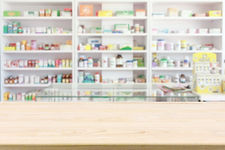 pharmacy-drugstore-counter-table-with-blur-abstract-backbround-with-medicine-healthcare-pr