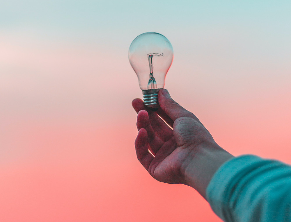 Holding up lightbulb - idea