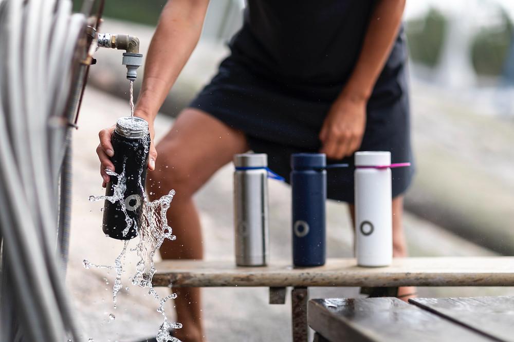 filling up water bottles
