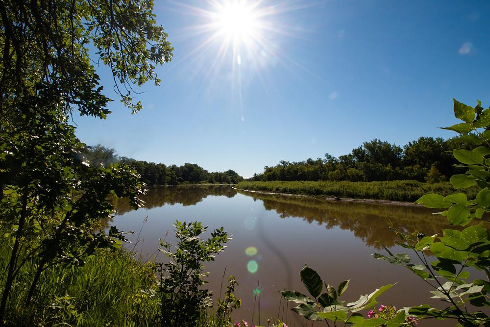 sun shining on lake