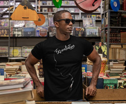 Handsome African man with shades wearing an Exsouliation T-Shirt by Ryan Koriya