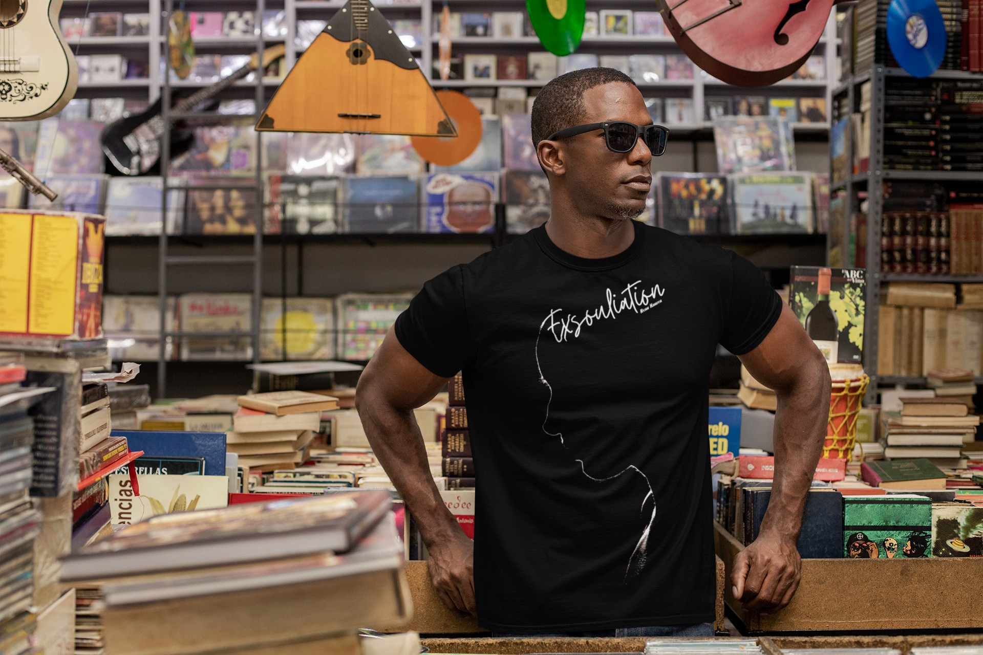 Handsome African man with shades wearing an Exsouliation T-Shirt