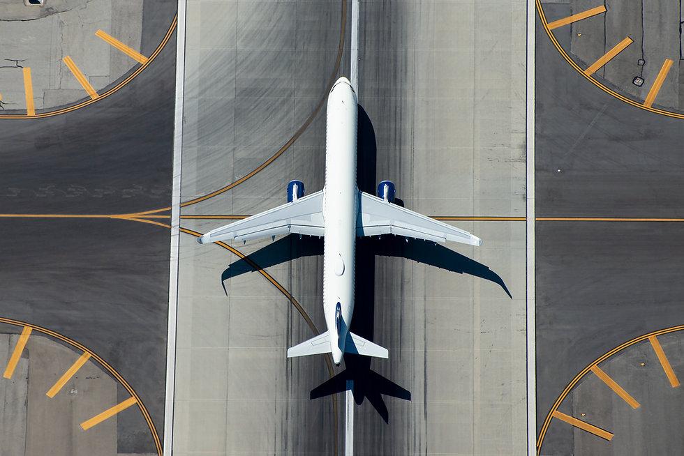 Aerial view of narrow body aircraft depa