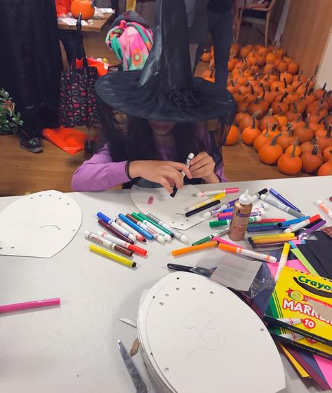 Girl drawing on mask