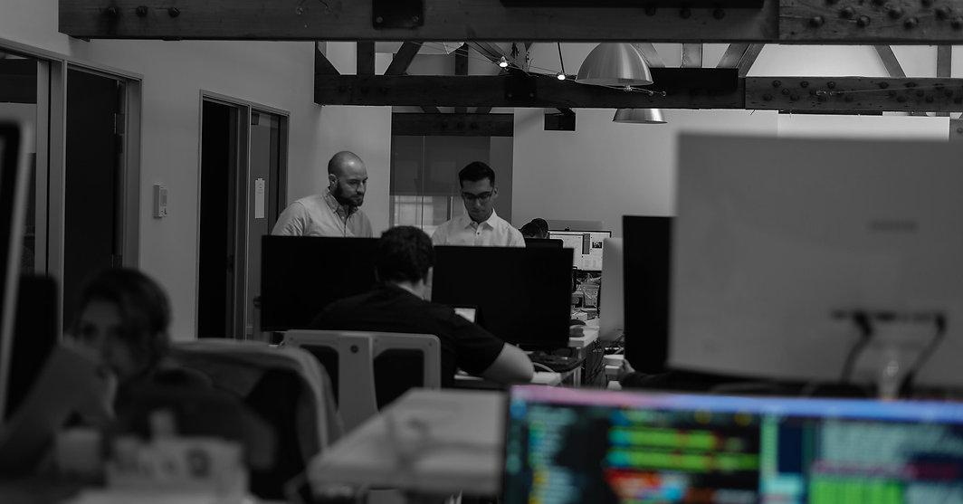TokenSoft office featuring Mason Borda and James Poole