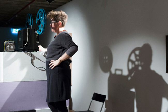 A Dinner Party: Setting theTable // 'Imaging Her World: Feminist Visions' // Projectionist Marcia Jane // Photograph by Catherine Evans