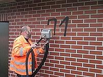 graffiti verwijderen muur.jpg