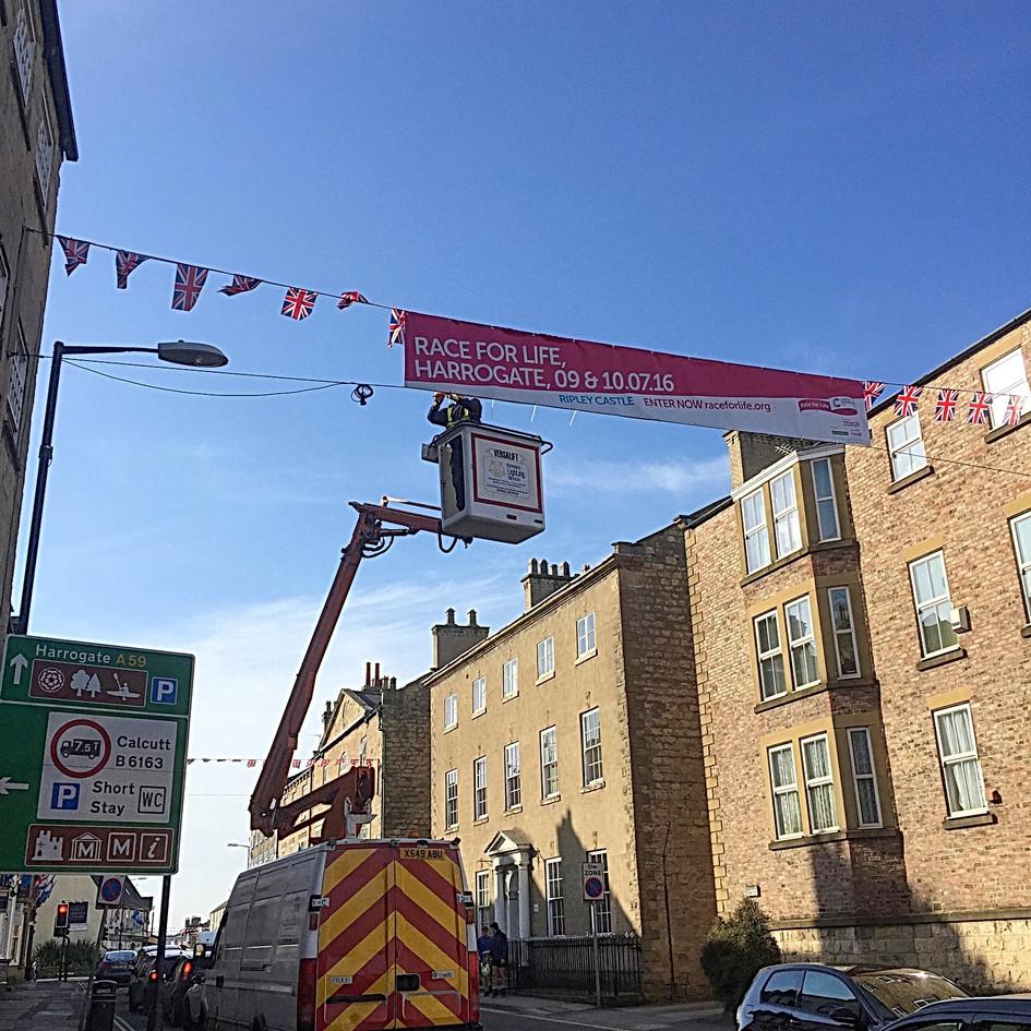 Banner installation high above a street in Knaresborough, Yorkshire