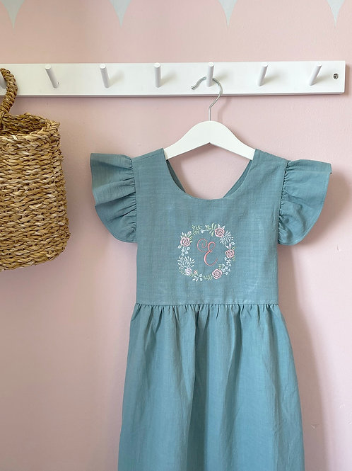 Embroidered tie back linen dress (floral wreath design)