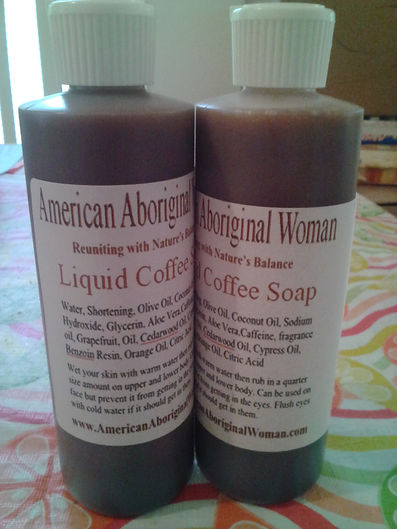 Clear bottle with white A A W Body Care Liquid Coffee Soap label with brown writing.