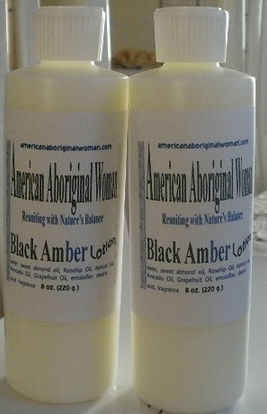 Picture of white bottle with label A A W Body Care Black Amber lotion.