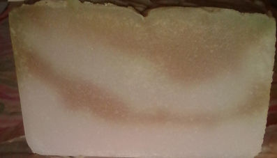 Off white soap with light brown streaks through soap.