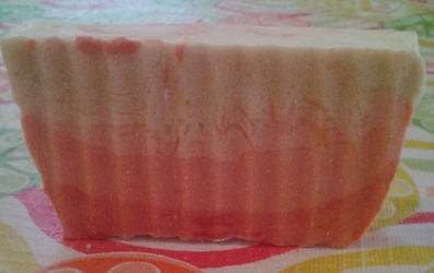 Beige soap with dark and light peach coloring at bottom.