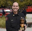 Chief Garcia accepting award.JPG