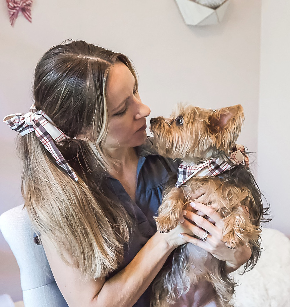 Dog mom and dog wearing matching hair bow and bandanas for dog gift ideas