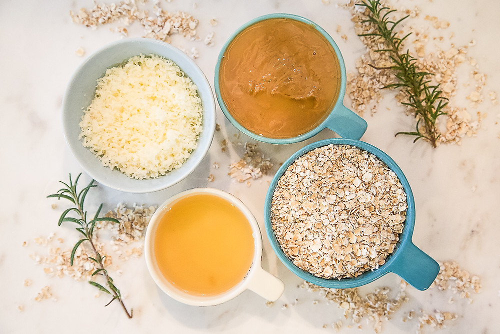 Four ingredients including peanut butter, rolled oats, cheddar cheese, and chicken stock for dog treat recipe