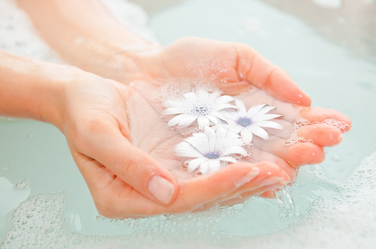 female hand and flower in water.jpg