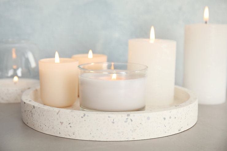 Tray with burning aromatic candles on ta