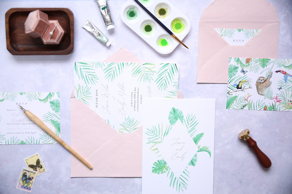 tropical leaves wedding stationery set illustrated in watercolour paints and wax seal stamp