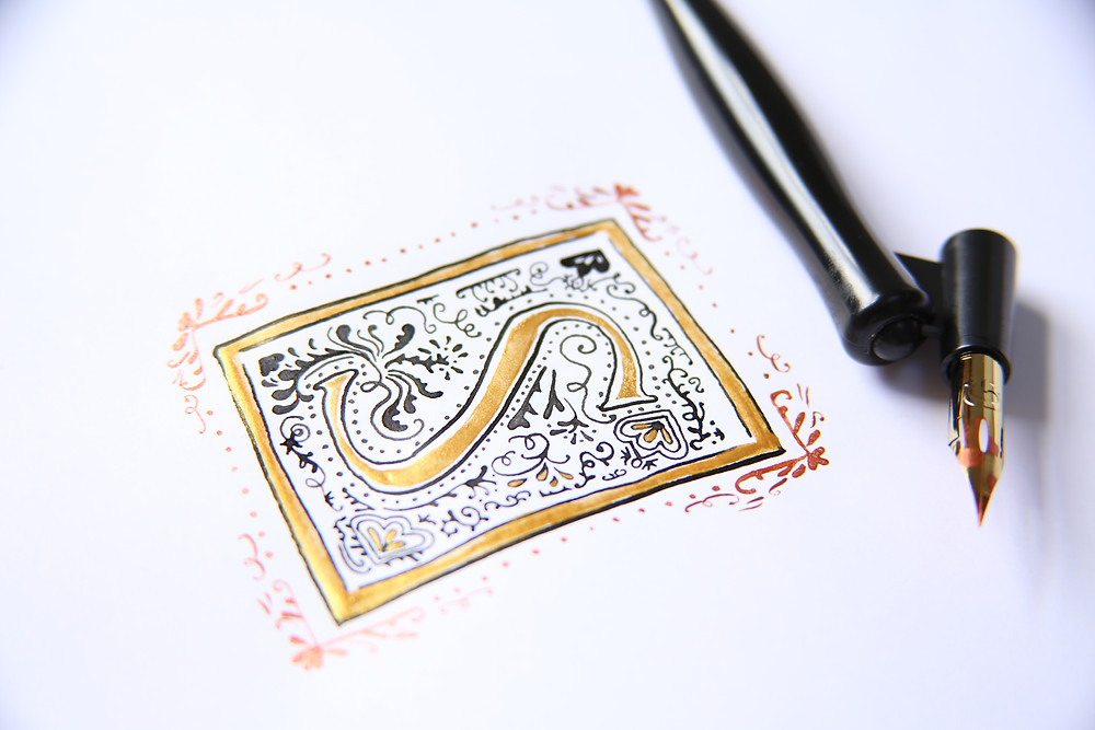 calligraphy illuminated letter