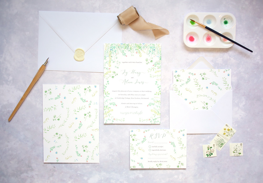 white wax seal on white envelope with illustrated floral garden wedding invitation