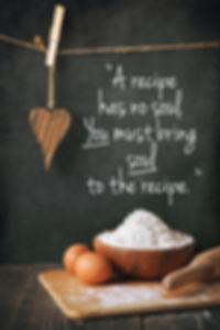 Flour and eggs on a blackboard backgroun