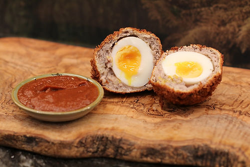 The Rambling Inn scotch eggs, encasd in imported Irish sausage, balck pudding, rolledin bread crumbs and deep fried.