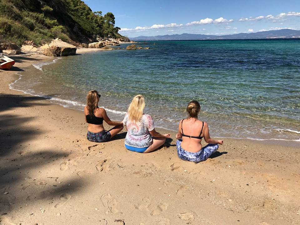 meditation on beach with girls