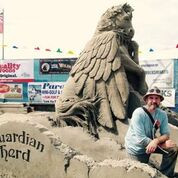 Artist Damon Langlois and his sand sculpture of Star from the Guardian Herd book series