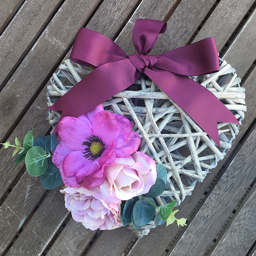 Purple artificial floral heart wreath