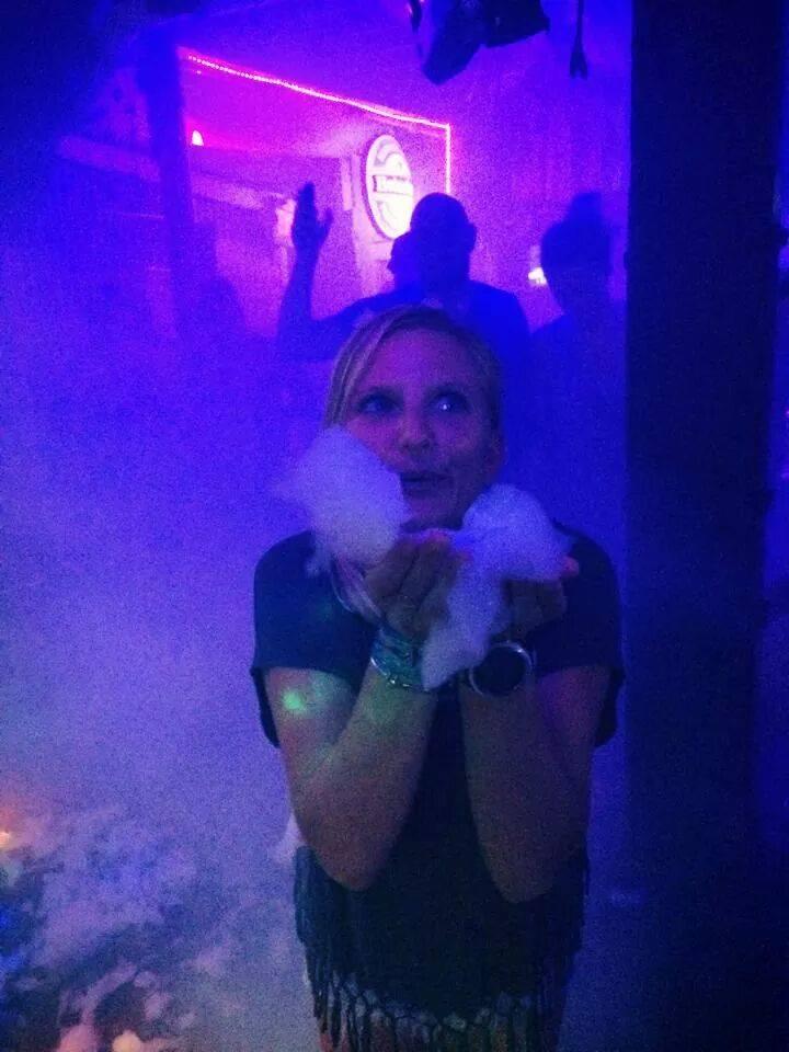Girl enjoying the Snow inside a club where I brought a Snow Machine.