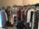Disorganized women's clothing in a closet.