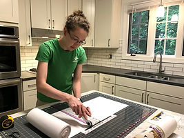 Woman cutting liner in kitchen