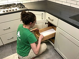 Woman inserting liner in kitchen drawer