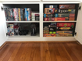 Organized game cabinet by Solutions for Stuf