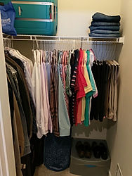 Clothing, shoes, suitcase, and laundry oganized by Solutions for Stuff