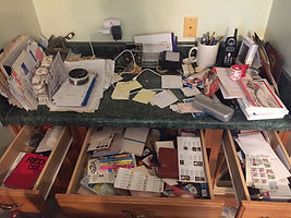 Disorganized desk and drawers