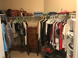 Women's clothing and accessories organized in a closet by Solutions for Stuff.