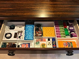 Empty boxes repurposed as drawer organizers by Solutions for Stuff