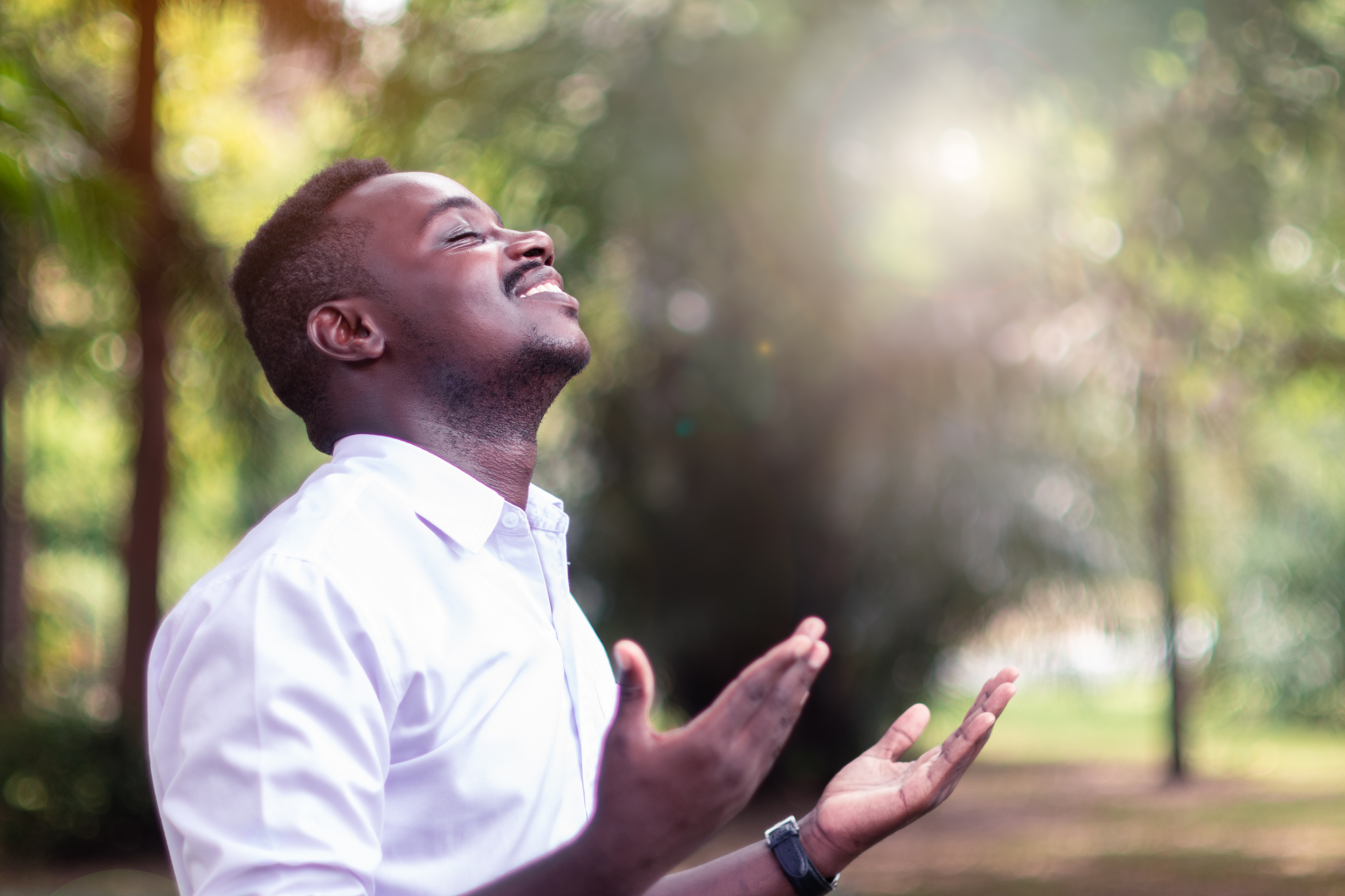 African man praying for thank god with l