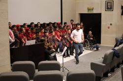 Rebal cunducting the choir