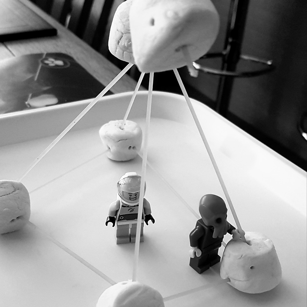 picture of spaghetti and marshmallow pyramid with toy figures