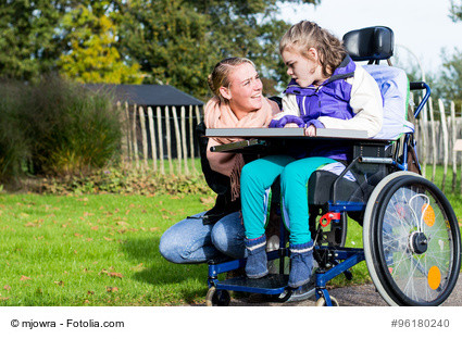 woman and girl in wheelchair