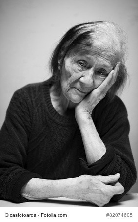depressed older woman with head in her hand