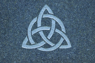 Trinity knot on stone surface.jpg