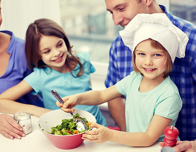 family cooking healthy meals together